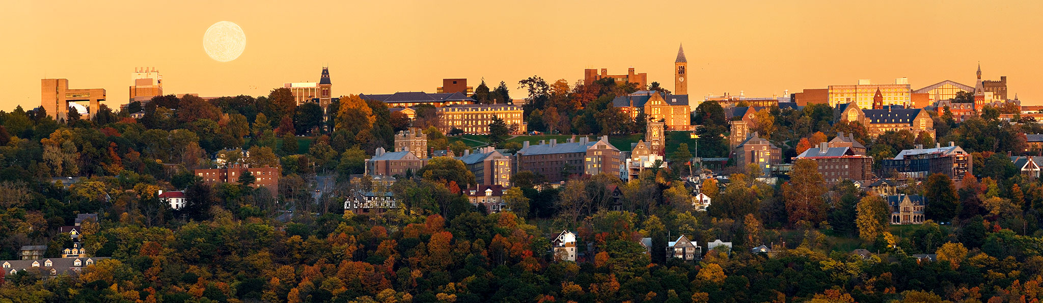A panoramic of campus during an autumn sunset (with full moon rising) from the west hill.