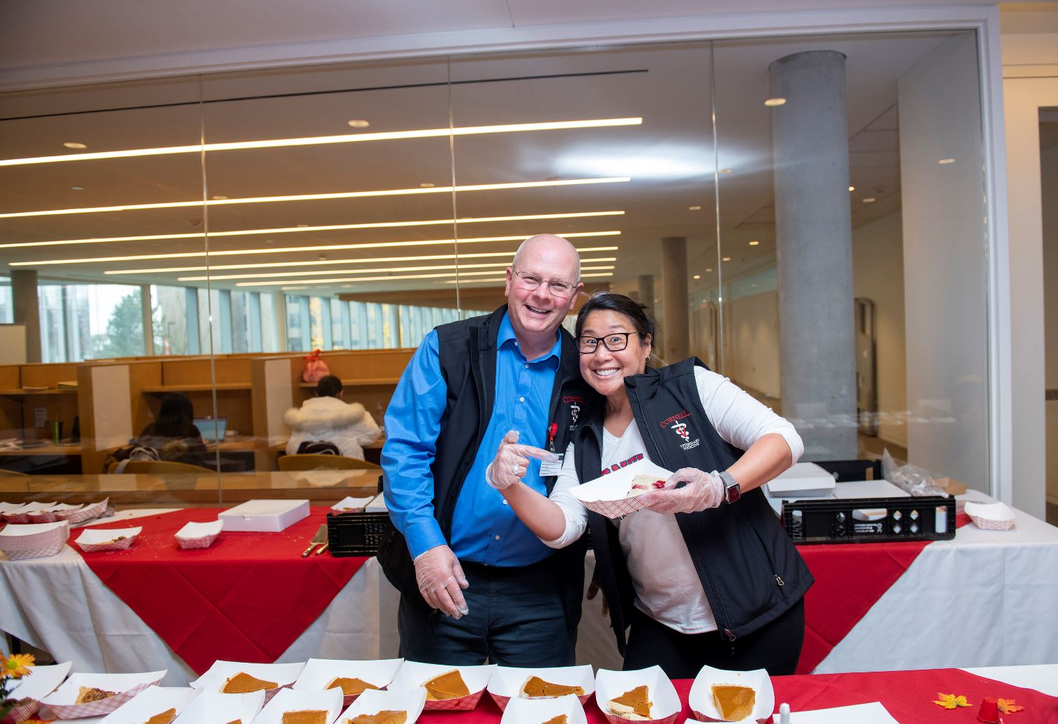 Bob Wakeman and Carolyn Chow of CVM HR serve pie at a CVM event