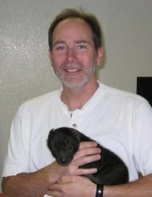 photo of Ned Place and hyena cub