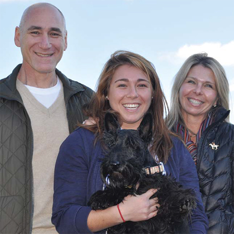 The Hoffman family with their Scottish terrier Buzz