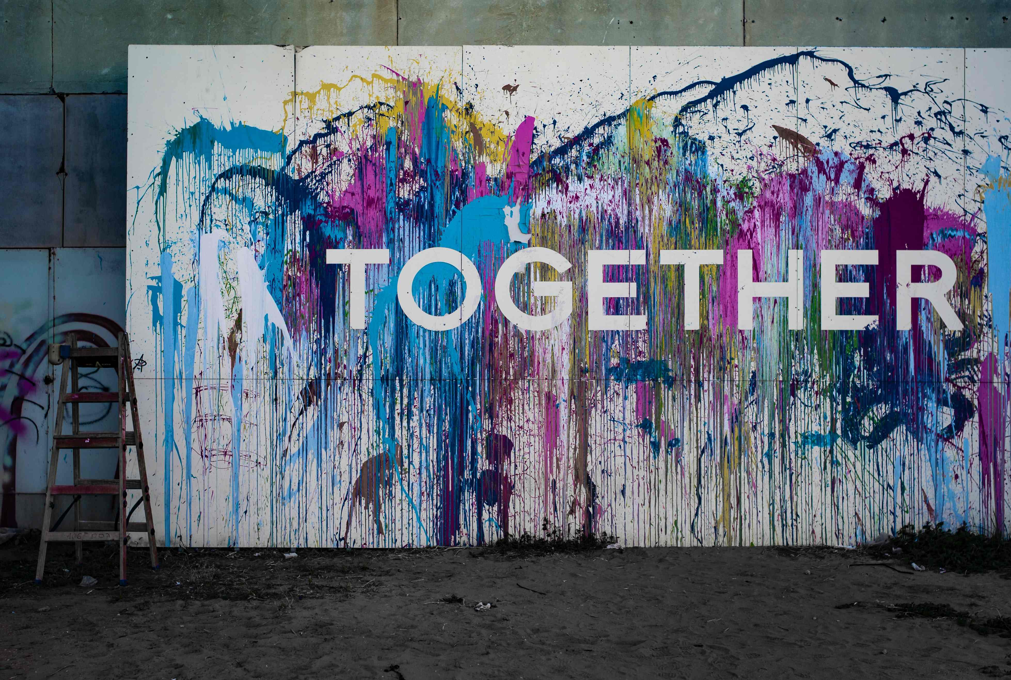 A mural that reads 'Together'