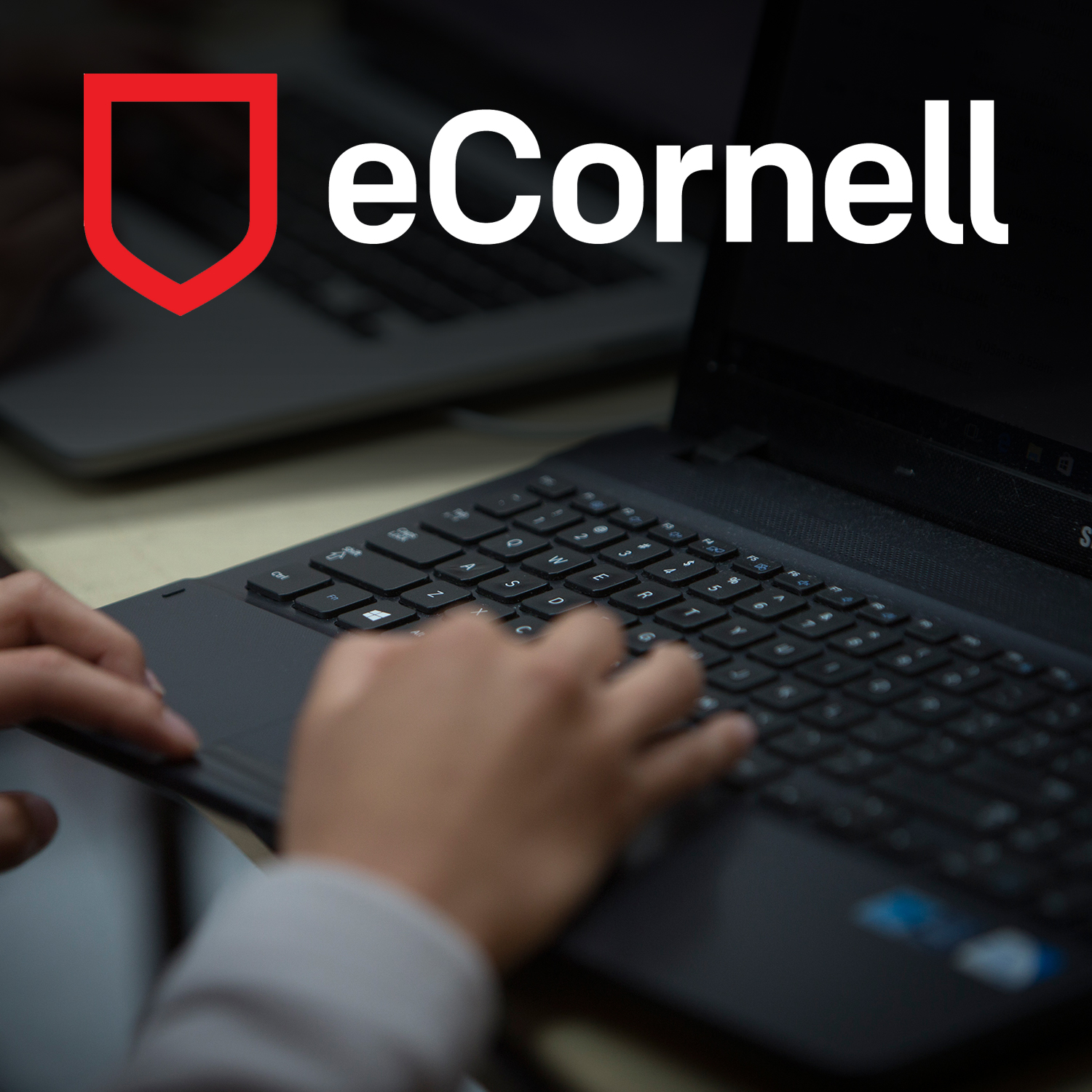 laptop with eCornell logo