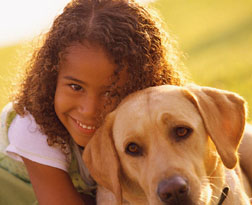 girl with yellow lab