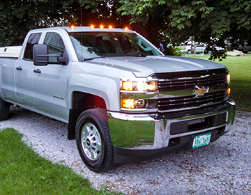 White Truck with it's lights on