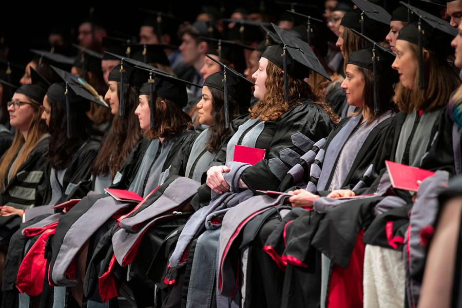 Graduates seated at hooding ceremony
