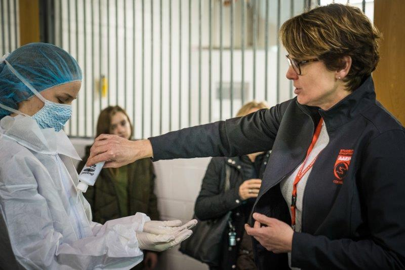 Dr. Gillian Perkins pours some fake germs on tour participants.