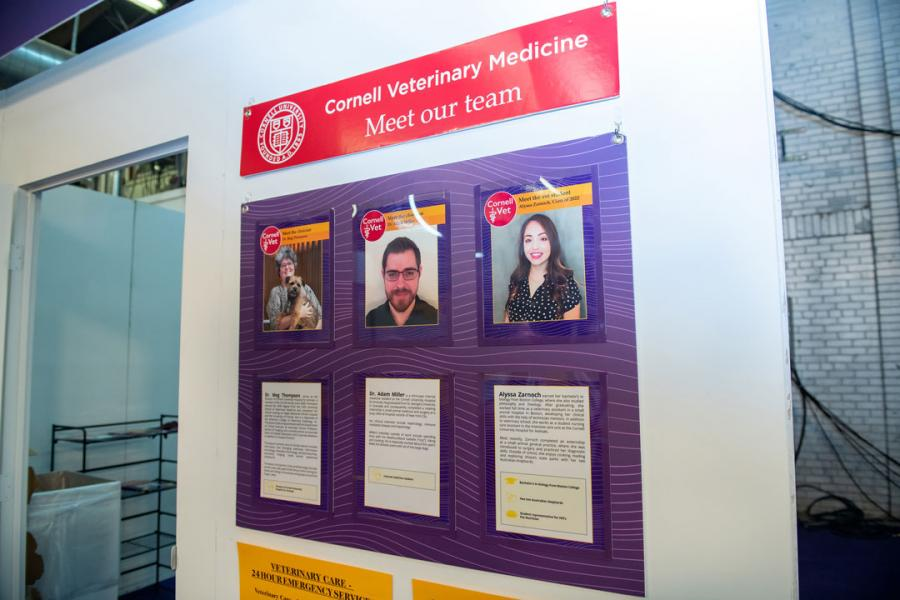 A display hanging on the vet tent explaining who the students and clinicians are