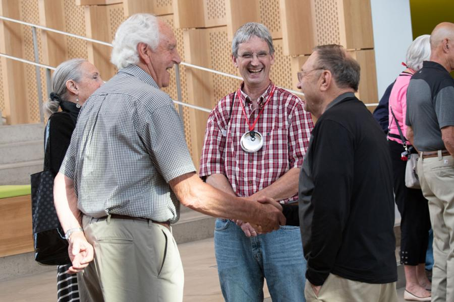 Reunion attendees greet each other in the atrium
