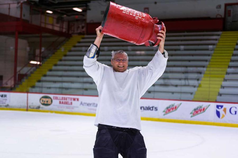 Another person lifts the cup