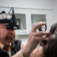 Dr. Thomas Kern performing an eye examination