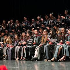 Veterinary graduates seated during the hooding ceremony