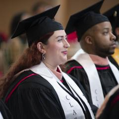 Seated MPH students during their hooding ceremony
