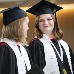 Two MPH students during their hooding ceremony