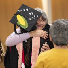 An MPH graduate hugging a family member