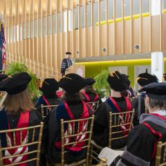 Dr. Alexander Travis speaking to crowd during MPH hooding ceremony