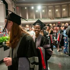 Students walking during hooding ceremony