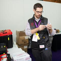A veterinarian preparing the supplies at the vet tent