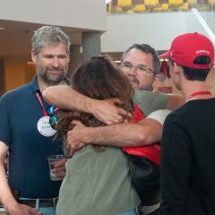 Reunion 2018 attendees hugging