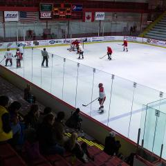 Another wide shot of the hockey game