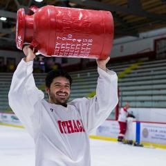 A person lifts the cup