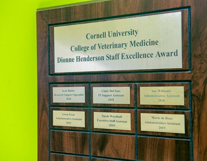A plaque noting the winners of the Dionne Henderson Staff Excellence Award