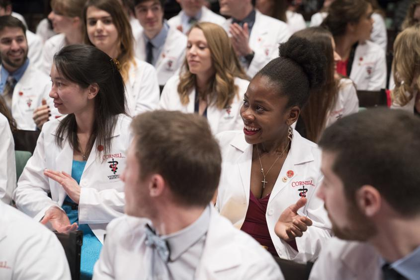 DVM students sit in Bailey Hall for their White Coat Ceremony