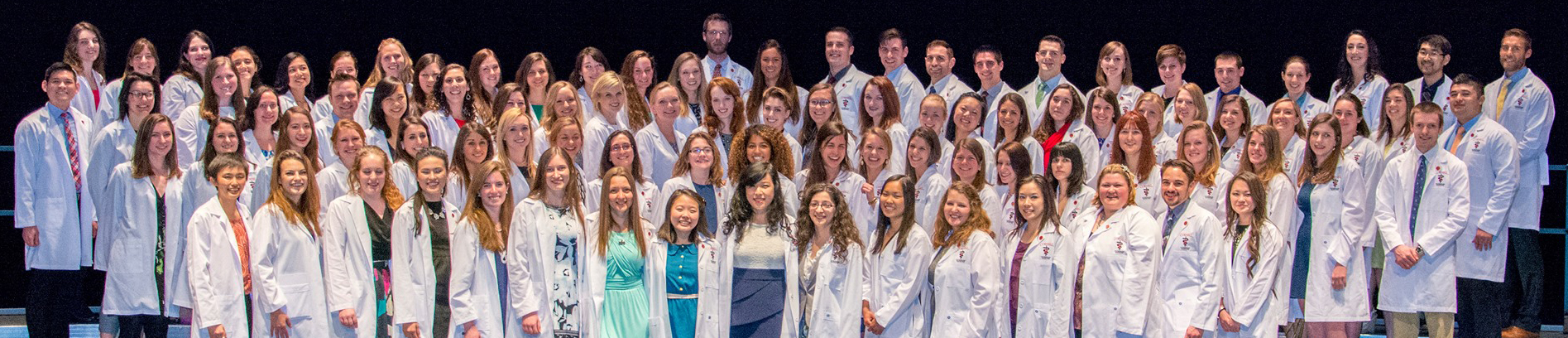 Image of DVM Graduating class in white coats